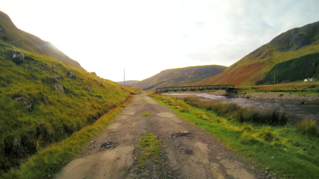 scotland driving past bridge - dirt road stock videos and b-roll footage
