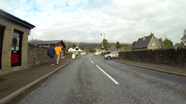scotland driving small town - car point of view stock videos & royalty-free footage