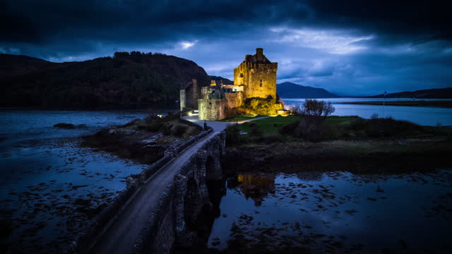 scotland eileen donan castle - aerial shot - castle stock videos & royalty-free footage