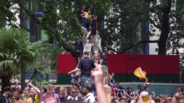 scotland fans celebrate and cheer on their football team in leicester square on june 18, 2021 in london, england. england v scotland is not only the... - 六月点の映像素材/bロール