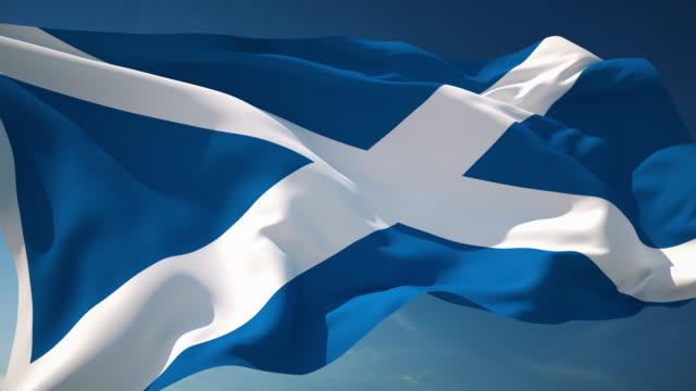 4k scotland flag - loopable - scottish flag stock videos & royalty-free footage