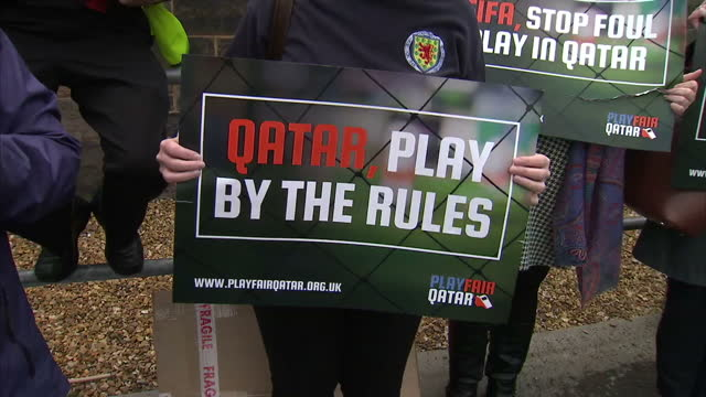 scotland football fans protesting about human rights issues during qatar world cup preparation, outside aviva stadium in glasgow. the fifa corruption... - fifa stock videos & royalty-free footage