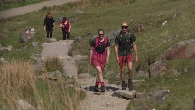 scotland has warmest day of the year so far scotland ext hikers walking up mountain - scotland stock videos & royalty-free footage