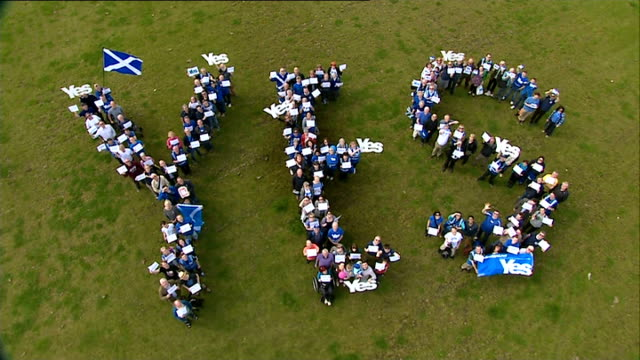 100 days to go 762014 view aerial of 'yes' campaigners spelling out the word 'yes' on grass 'yes' campaigners stall at event with literature and... - spelling stock videos & royalty-free footage