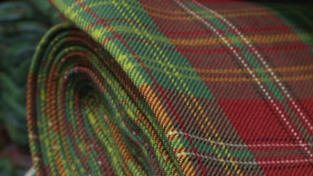 scotland voted overwhelmingly to remain in the european union last week and now scottish business owners such as those producing tartan and whiskey... - tartan stock videos & royalty-free footage