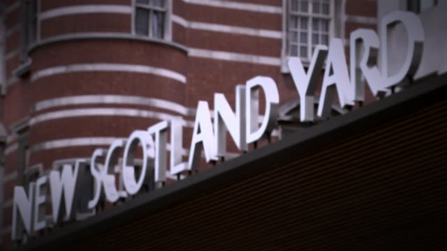 Scotland Yard examining upcoming rape trials after collapse of two recent prosecutions Date unknown London EXT Sign 'New Scotland Yard' Metroolitan...