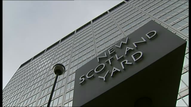 scotland yard vip paedophile ring investigation criticised in report ext gv new scotland yard revolving entrance sign police car reflected in... - pedophilia stock videos and b-roll footage