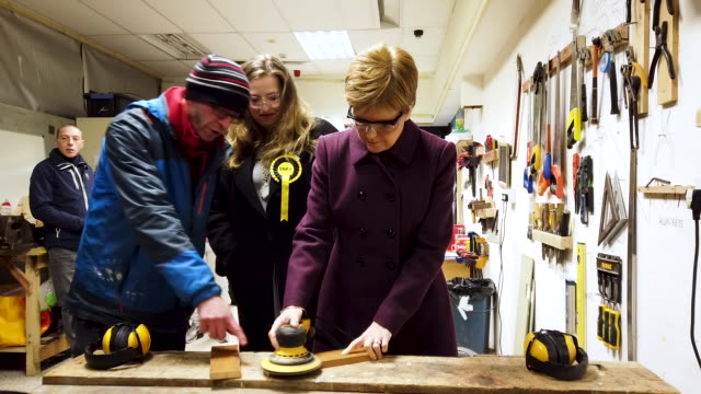 scotland's first minister and snp leader nicola sturgeon accompanied by edinburgh west candidate sarah masson tries her hand at woodworking as she... - scottish national party stock videos & royalty-free footage