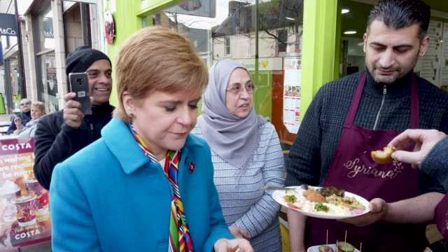 scotland's first minister and snp leader nicola sturgeon meets local activists and supporters in a town centre walkabout, also visiting a cafe and a... - nicola sturgeon stock videos & royalty-free footage