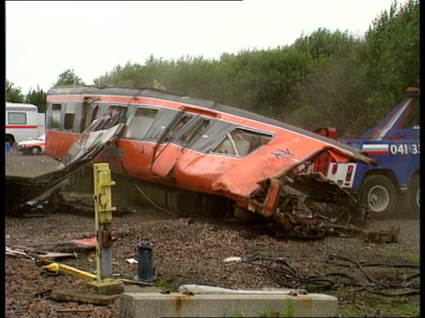 scotrail train crash nat glasgow newton station ms wrecked carriage being turned upright ms british rail engineers operating jack lms train wreckage... - train crash stock videos & royalty-free footage