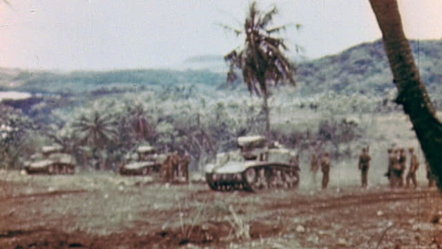 scott howitzer driving at speed through dusty fields and m4 sherman tanks with infantry advancing more slowly / saipan mariana islands - mariana islands stock videos and b-roll footage