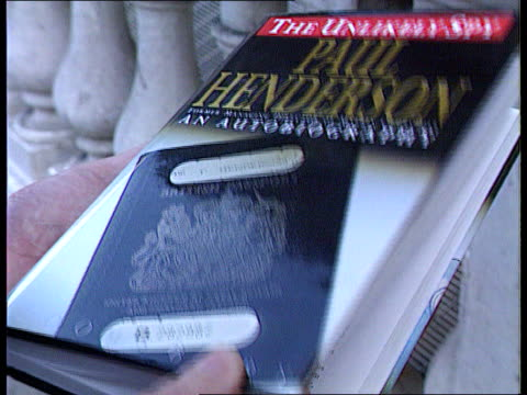 """paul henderson evidence; cms copy of paul henderson autobiography """"the unlikely spy"""" on table cms pages in book sentence in book highlighted """"i... - paul henderson stock videos & royalty-free footage"""
