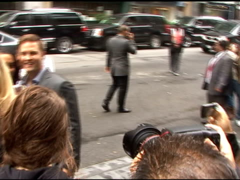 Scott Porter talks with fans as he arrives at the CW Upfronts in New York 05/19/11