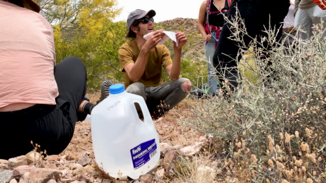 scott warren, a volunteer for the humanitarian aid organization no more deaths pauses while delivering food and water along remote desert trails used... - human face video stock e b–roll