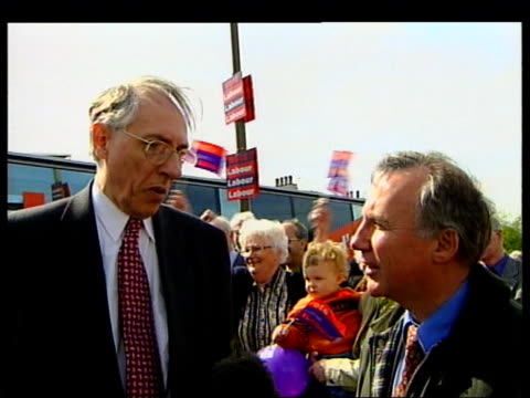 edinburgh scottish secretary donald dewar mp greeted as from campaign bus dewar speaking with people donald dewar mp interview sot don't know what... - alex salmond stock videos & royalty-free footage