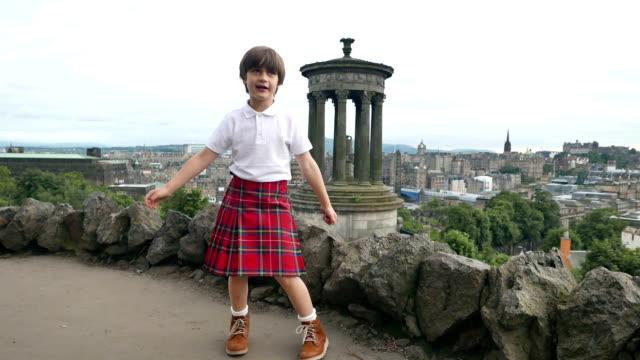 scottish calton hill with a boy in kilt - kilt stock videos & royalty-free footage