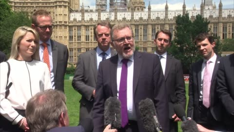 stockvideo's en b-roll-footage met scottish conservative mps photocall in westminster; england: london: westminster: ext david mundell mp along for photocall with other scottish... - victoria tower