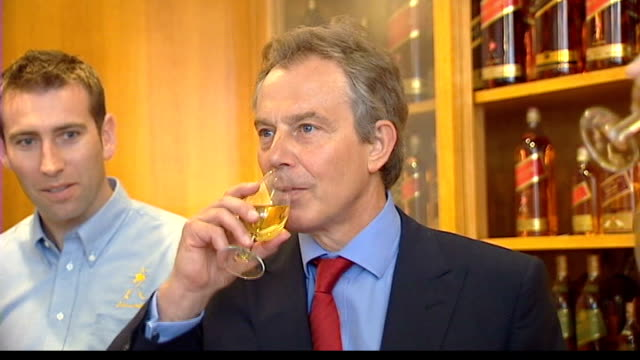 blair criticises snp's plans for independence referendum; scotland: int tony blair mp drinking whisky - mp stock-videos und b-roll-filmmaterial