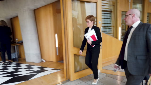 scottish first minister nicola sturgeon on the way to the chamber of the scottish parliament for the stage three stage debate on the transport bill... - holyrood bildbanksvideor och videomaterial från bakom kulisserna