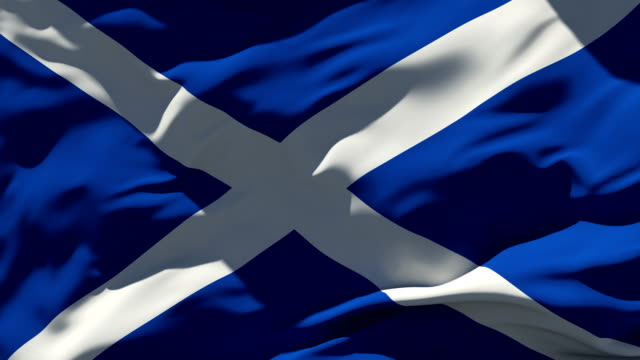 4k scottish flag - loopable - scotland stock videos & royalty-free footage
