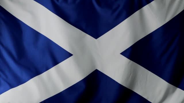 cu scottish flag waving / berlin, germany - scottish flag stock videos & royalty-free footage