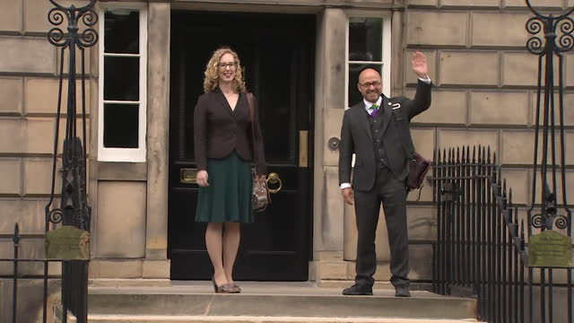 scottish green party co-leaders patrick harvie and lorna slater arriving at bute house after striking a formal partnership with the snp - coworker stock videos & royalty-free footage