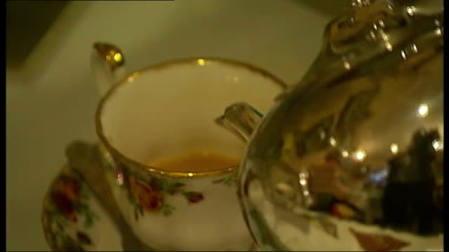 david cameron calls for support from 'silent majority' ext **music overlaid sot** exterior of 'small talk traditional tea room' cakes on plates pan... - tea cup stock videos and b-roll footage