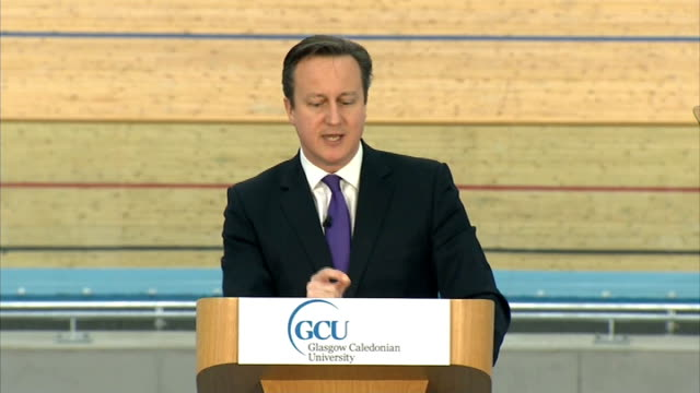 scottish independence: david cameron gives speech in stratford; int david cameron mp along to podium group of people in centre of velodrome david... - water fight stock videos & royalty-free footage