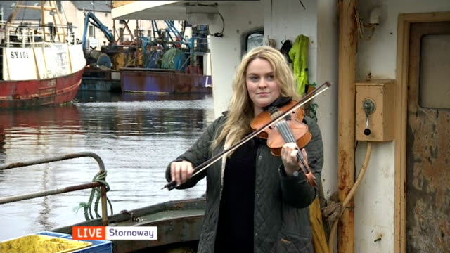 scottish independence: outer hebrides; scotland: outer hebrides: isle of lewis: stornoway: ext woman playing the violin on boat - hebrides stock videos & royalty-free footage