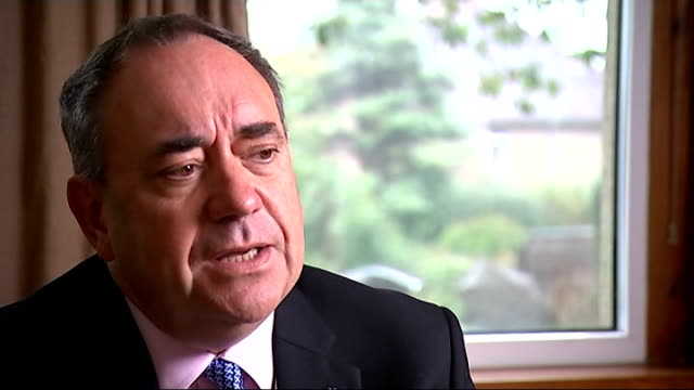 alex salmond campaigning scotland west lothian linlithgow ext alex salmond msp along and chatting to reporter low angle view house where salmond was... - linlithgow stock videos and b-roll footage