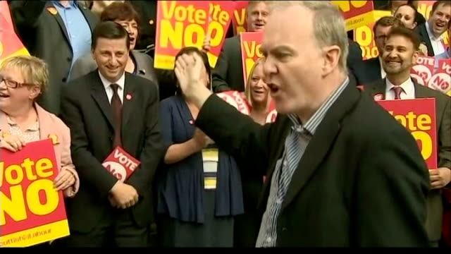 scottish independence referendum: banks threaten to relocate to london; scotland: glasgow: ext yes campaigner with scottish flag trying to disrupt... - douglas alexander stock videos & royalty-free footage