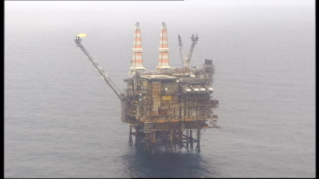scottish independence referendum: david cameron and alex salmond comment ahead of meeting; 2008 north sea: ext / at sea air view of oil rig platform... - north sea stock videos & royalty-free footage
