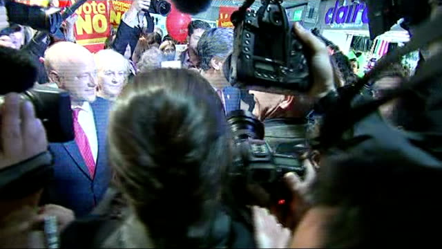 scottish independence referendum: ed miliband mobbed; scotland: edinburgh: st james shopping centre: ext handful of labour party no campaigners along... - surrounding stock videos & royalty-free footage