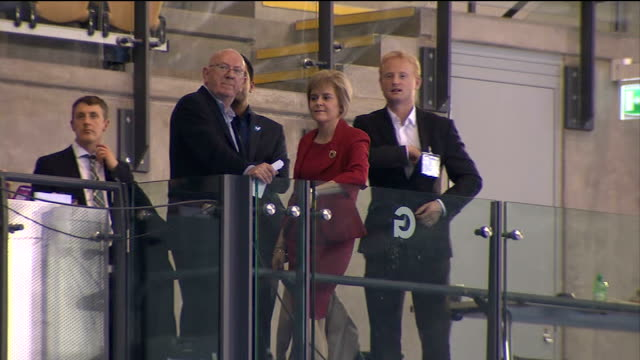 nicola sturgeon attends glasgow result campaigners celebrating result sot / sturgeon on balcony / george black along to podium and announcing result... - 2014 scottish independence referendum stock videos & royalty-free footage