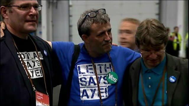 no campaign wins / alex salmond resigns yes campaign supporters having a group hug - 2014 scottish independence referendum stock videos & royalty-free footage