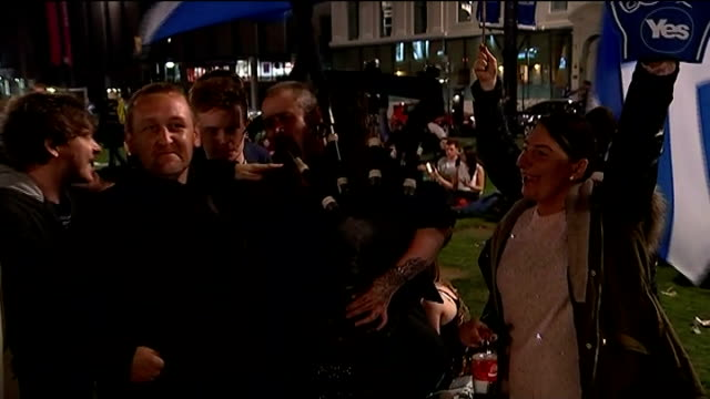 reconciliation after the vote result yes supporters gathered in square around bagpiper before the result of the referendum was known various of... - 2014 scottish independence referendum stock videos & royalty-free footage