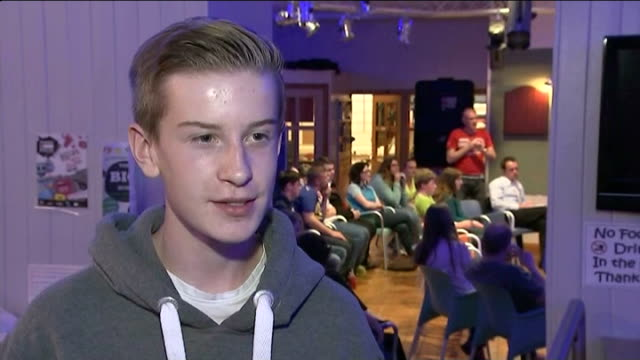 views of 16 and 17 year olds scotland elgin youth cafe int side view people at table during debate for young voters pan young voters listening young... - 2014 scottish independence referendum stock videos & royalty-free footage