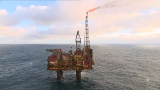 Scottish independence would result in 'economic boost' claims SNP report LIB / Brent oil field EXT AIR VIEWS / AERIALS of oil rig at sea / flame...