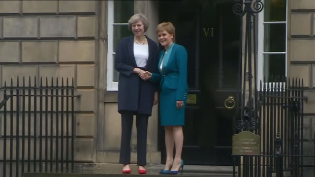Scottish independence would result in 'economic boost' claims SNP report 1572016 / R15071614 Edinburgh EXT Theresa May MP handshake with Nicola...
