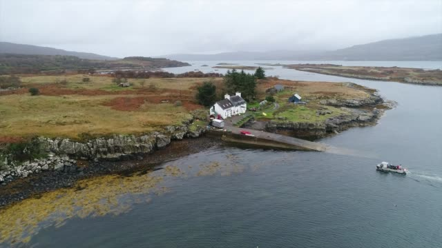 scottish island of ulva goes on sale for four and a half million pounds scotland inner hebrides ulva ulva island general view boathouse air views /... - hebrides stock videos & royalty-free footage