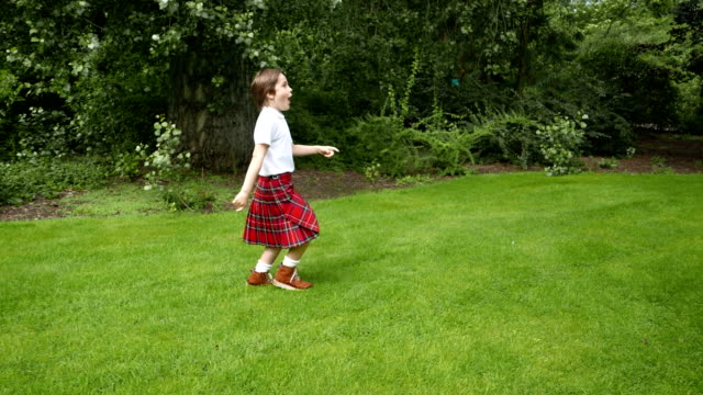 a scottish kilt boy running with a paper airplane - kilt stock videos & royalty-free footage