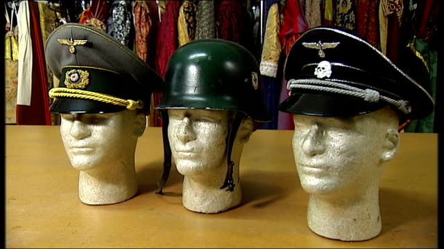 scottish labour mp resigns as media adviser over spoof hitler video; england: london: int three german military hats displayed on mannequin heads... - nazi swastika stock videos & royalty-free footage