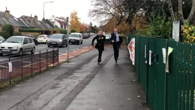 scottish lib dem leader willie rennie skips down a road with lib dem msp alex colehamilton on a campaign stop outside blackhall primary school in... - skipping along stock videos & royalty-free footage