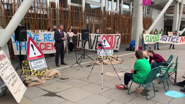 scottish liberal democrat msp liam mcarthur joins climate campaigners outside parliament msps have been urged to seize their final opportunity to... - pillow stock videos & royalty-free footage