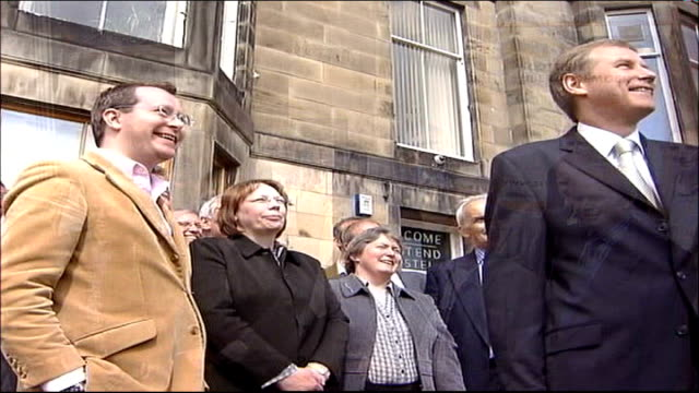 coalition talks nicol stephen msp posing with other liberal democrat msps for photocall outside liberal democrat offices nicol stephen msp interview... - scottish national party stock videos & royalty-free footage