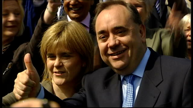 coalition talks scotland edinburgh ext alex salmond msp towards with snp members of the scottish parliament salmond posing for photocall with nicola... - scottish national party stock videos & royalty-free footage