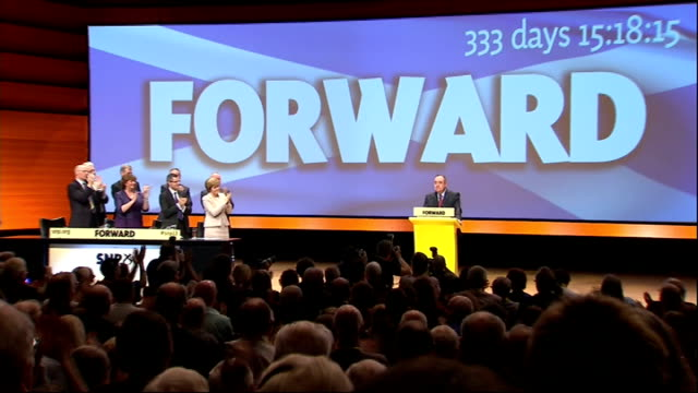 alex salmond speech **music heard sot** salmond at podium as audience applaud then along and leaving stage - scottish national party stock videos & royalty-free footage