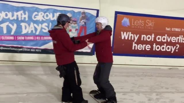 Scottish National Party Finance Minister Derek Mackay tries his hand at snowboarding at Snow Factor in Braehead Renfrewshireon