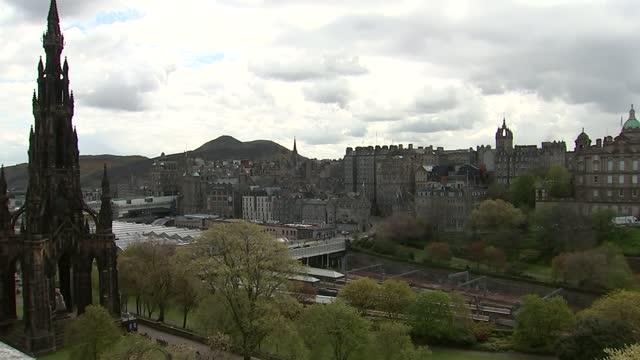 scottish parliament and edinburgh general views; scotland: edinburgh: ext gvs edinburgh castle / wide shots of edinburgh skyline from balmoral hotel,... - general view stock videos & royalty-free footage