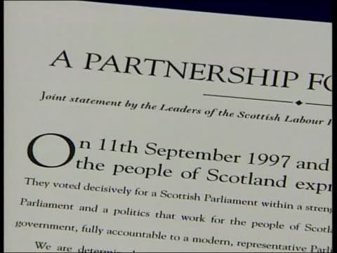 Lib Dem/Labour Coalition SCOTLAND Edinburgh Donald Dewar MSP Jim Wallace MSP signing documents formalising coalition deal between Labour the Liberal...